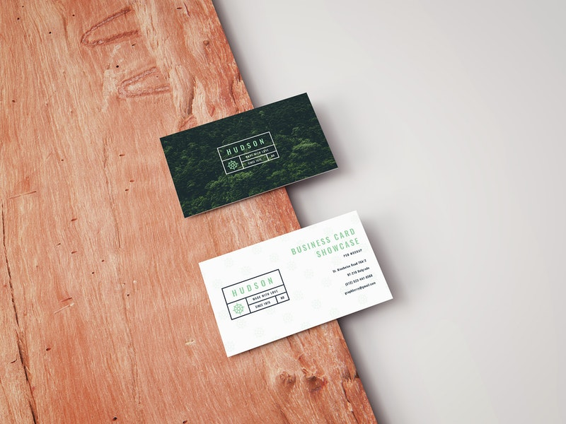 Free Business Card Mockup on a Wooden Board preview